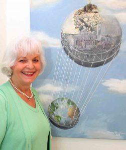 Immobilienblase: Die Erde wird getragen von einem beschädigten Ballon aus Gebäuden in dem Bild von Yvonne Nordhaus-Wentzel